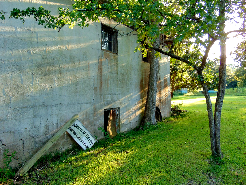 Great Aunt Ruby's old cinder block house and my great grandpa's work sign. #old #house #sign #antique #afternoon #sunlight #rays #shadows #tree #branches #wall #windows #broken #decrepit #photography